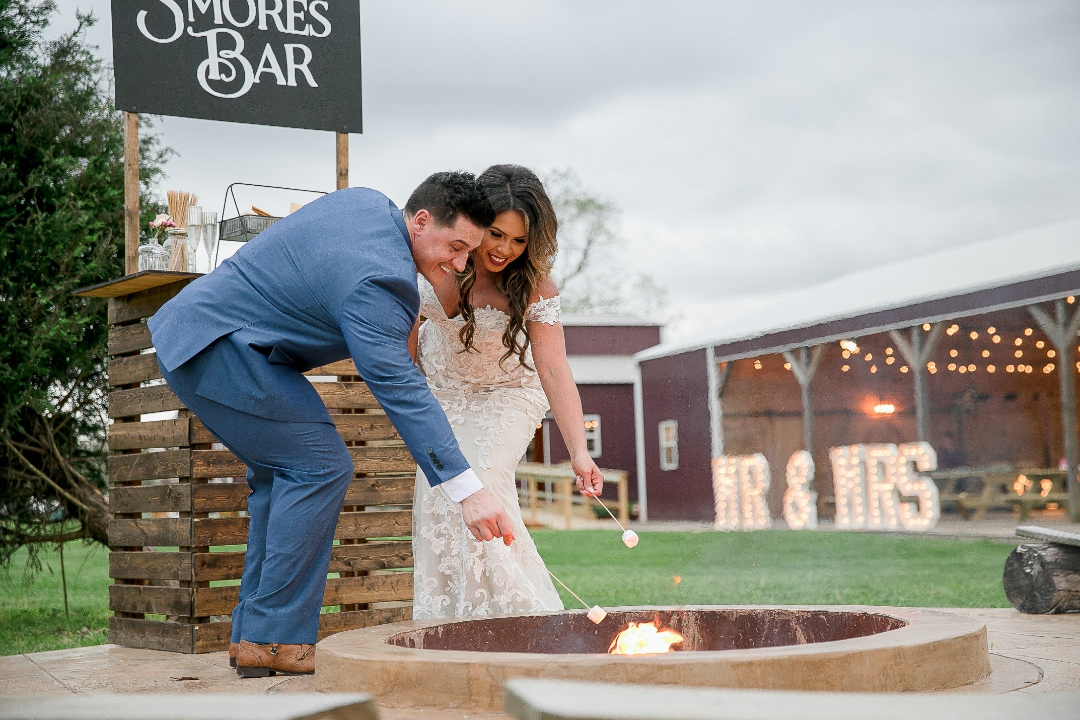 outdoor wedding couple fire